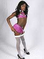 Ebony transsexual Eclair posing as a naughty schoolgirl