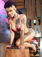 Tattooed Oliviah stripping in a warehouse