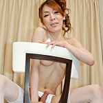 Sexy Japanese shemale does a seductive striptease