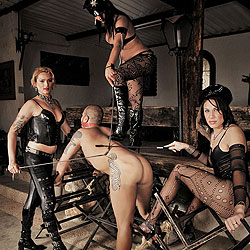 Three shemale punishers and their slave