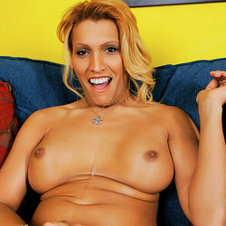 Blonde tranny strips and teases