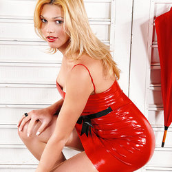 Stunning blonde shemale in red latex