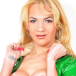 Stunning blonde shemale teases in latex