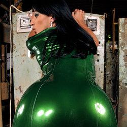 Shemale clad in metallic green latex