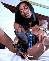 Stunning ebony beauty Natalia Coxxx stripping in bed