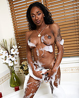 Chocolate hotness Natalia Coxxx taking a bath