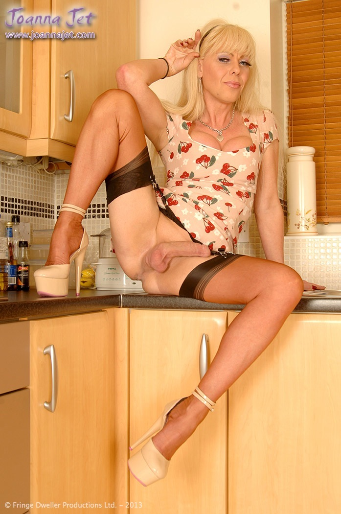 image Heeled tgirl tugging after showing bigtits